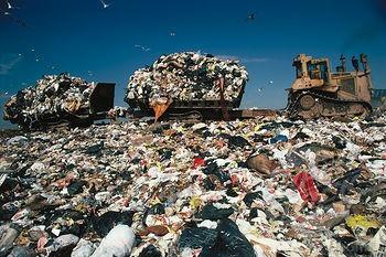 bulldozer pulling rubbish trailer.jpg